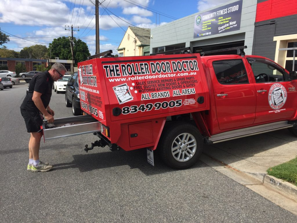 Remote control doors in adelaide the roller door doctor andrew with roller door doctor work vehicle rubansaba