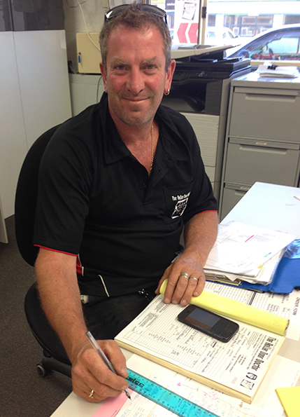 Andrew making plans for roller door maintenance in Adelaide